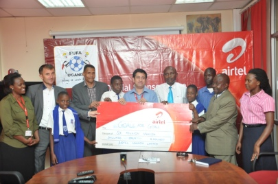Mr. Arindam Chakrabarty during the handover of Goal for Goals money to St. Ponsiano Kyamula Primary School