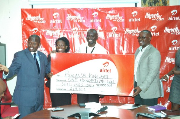 L-R Buganda's sports and recreation minister Mr. Henry Ssekabembe a Buganda representative, Alex Wekoye, Airtel Brand Manager and Mr. Nuhu Kanyike, Airtel Mobile Money Director