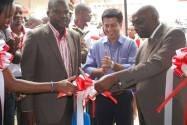 L-R Michael Walokwe, Airtel Sales and Distribution Director, Arindam Chakrabarty Airtel MD and Mayor of Mbarara, Wilson Tumwine at the Mbarara Premium Shop Opening