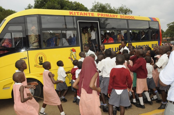 Kitante Primary School pupils surround the new bus that Unilever handed over to the school for emerging best in the puzzles school challenge promo