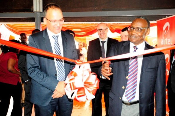 Airtel Board Chairman Mr. Chris Kassami cuts the ribbon to launch the new shop alongside Airtel M.D. Mr. Tom Gutjahr