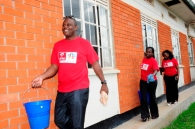 Airtel staff members participate in a cleaning activity at the Cheshire Homes