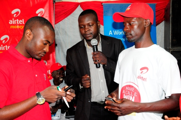 Members demonstrating how the Airtel Money savings product is done.