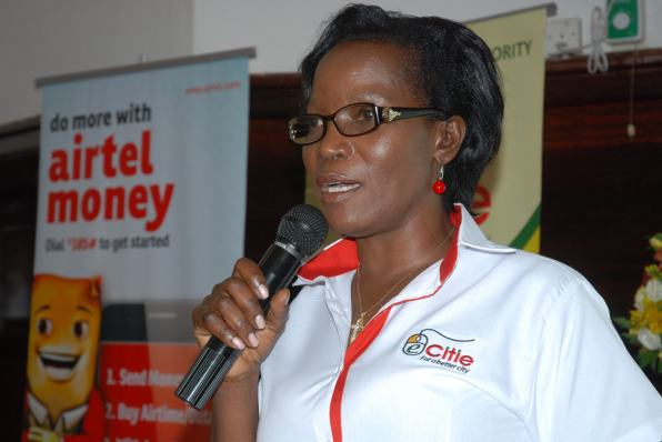 KCCA Executive Director Mrs. Jennifer Musisi addresses guests during the launch of the Airtel and KCCA payment system