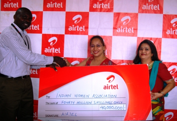 L-R Alex Wekoye, Head Brand & Communication Airtel Uganda hands over a cheque to Mrs. Gurmeet Kaur (chairperson IWA) & Mrs. Suman Venkatesh (vice-chairperson IWA)