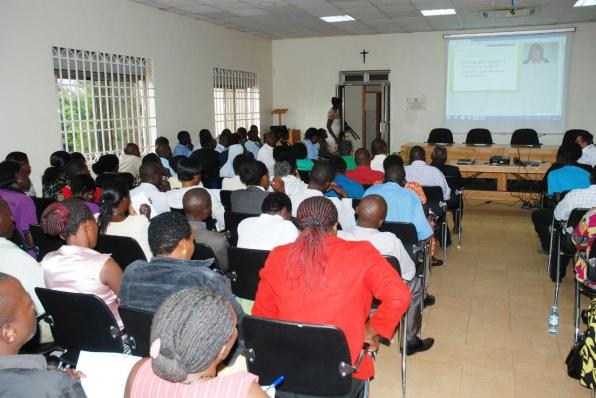 Participants listen to Prof. Dr. Gabriele Gien (On screen) delivering her lecture. This was during the launch of the Uganda E-Learning Project at the Permanent Center for Education