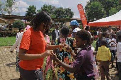 Airtel Rwanda CSR & Corporate Communications manager Denise Umunyana dancing with the children at the Airtel Rwanda Children Xmas Party at CHUK