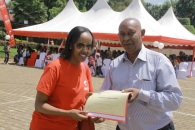 Airtel Rwanda CSR & Corporate Communications manager Denise Umunyana receives a certificate of appreciation from Prof. Mugannga Narcisse, who represented CHUK's doctors