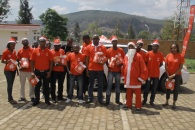 Airtel Rwanda staff pose for a picture before giving the children their xmas gifts at CHUK