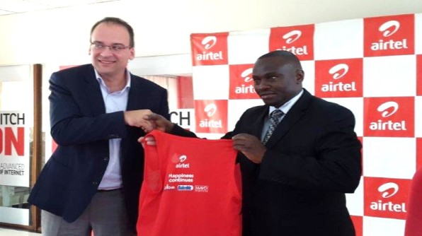 Airtel Uganda M.D Mr. Tom Gutjahr officially hands over the kits to Mr. Sekabembe Henry, the Buganda Kingdom Minister of Sports