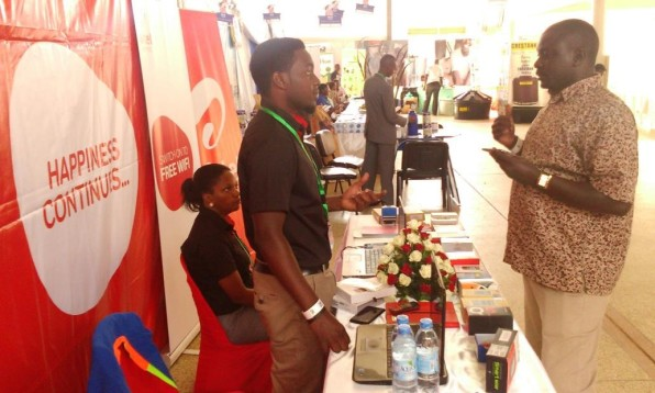 An Airtel Uganda Direct Sales Executive explains to a customer about the new 'Tugabane' product at the Airtel booth during the Agripreneur EXPO at UMA showground
