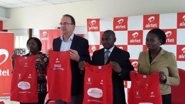 Ms. Remmie Kisakye, Media Manager Airtel Uganda, Mr. Tom Gutjahr MD Airtel Uganda, Mr. Sekabembe Henry, Buganda Minister of Sports and Omumbejja Daniella Nakayenga display the kits Airtel Uganda handed over to the Kingdom