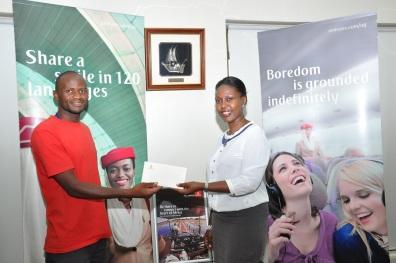 One of the winners, Emotu Peter with Emirates Sales Manager Uganda, Noelene Nyonga