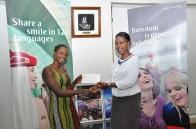 One of the winners, Faith Ibwaot with Emirates Sales Manager Uganda, Noelene Nyonga