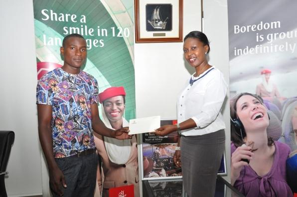 One of the winners, Pharis Cutis with Emirates Sales Manager Uganda, Noelene Nyonga