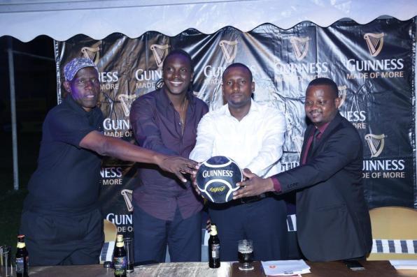 Jimmy Kirunda (L), David Obua (2L) and NBS TV's Joseph Kigozi (R) join Mark Mugisha (2R) to launch the Get Booked campaign with Guinness