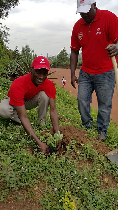 Airtel Rwanda Managing Director, Michael Adjei planting a tree at the Umuganda activities in Kacyiru