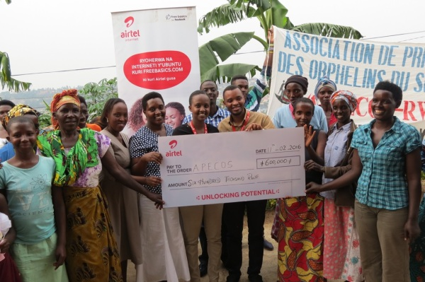 Airtel Rwanda staff with some of the beneficiaries of APECOS