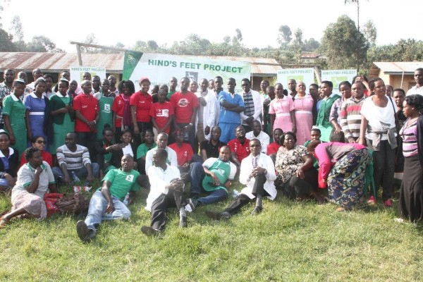 Airtel Uganda staff members pose for a group photo with Hind's feet project volunters during the Health fair in Kabale