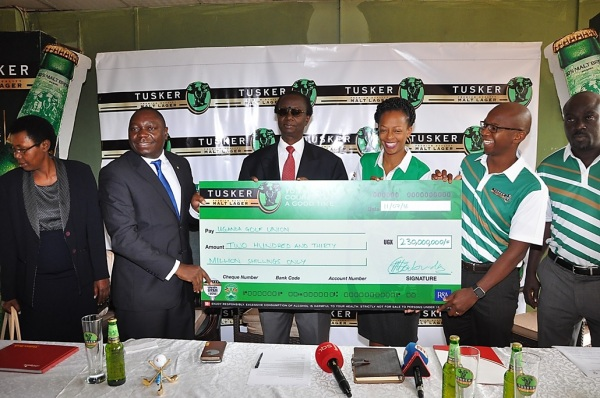UBL Manging Director Mr. Nyimpini Mabunda hands over the dummy cheque to Johnson Omolo the President of the Uganda Golf Union