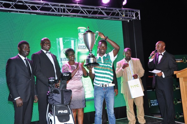 2016 Tusker Malt Uganda Golf Open winner Ronald Otile being presented by hi trophy