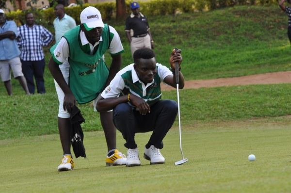 Ronald Otile checks out the ball line for his final play of the Tusker Malt Uganda Open.
