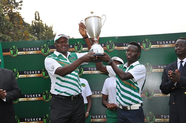 Uganda Breweries Managing Director presents the Tusker Malt Uganda Open trophy to Ronald Otile 2