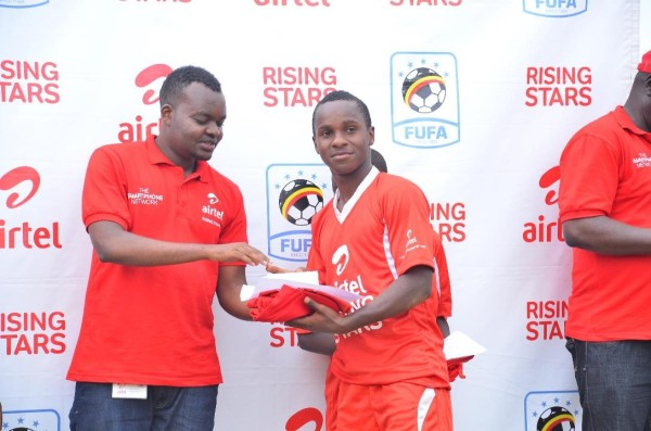 airtel-uganda-brand-and-assets-executive-musa-mayanja-awards-the-ars-2016-buganda-region-mvp-kafumbe-masood-with-a-brand-new-smartphone-and-an-airtel-tshirt