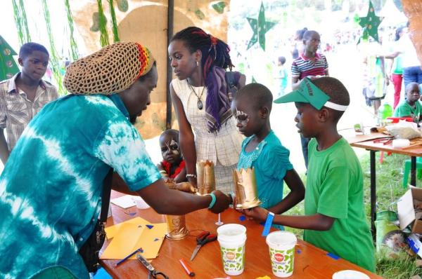 a-gentleman-teaches-kids-how-to-make-masks-from-used-milkman-cans-this-was-during-the-milkman-recycling-workshop-at-the-go-green-festival