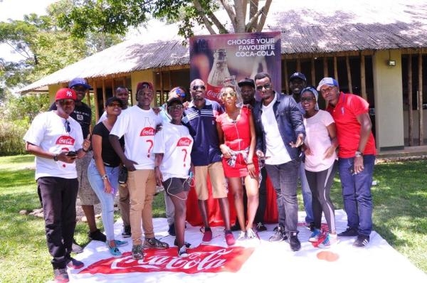 Coca-Cola Uganda Brand Manager Rodney Nzioka poses with some of the invited guests during the launch of the Coca-Cola with Zero Sugar at Lakeside Adventure park