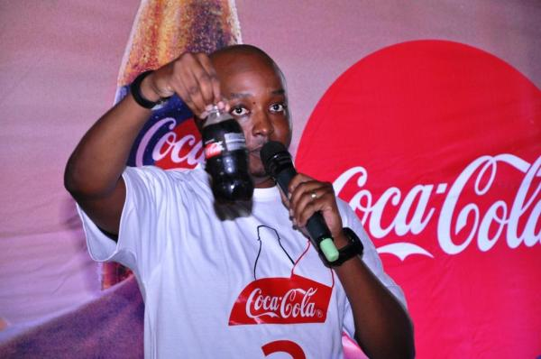 Mr. Rodney Nzioka, Coca-Cola Uganda Brand Manager displays the new Coca-Cola with Zero Sugar during the launch at Lakeside Adventure Park in Mukono